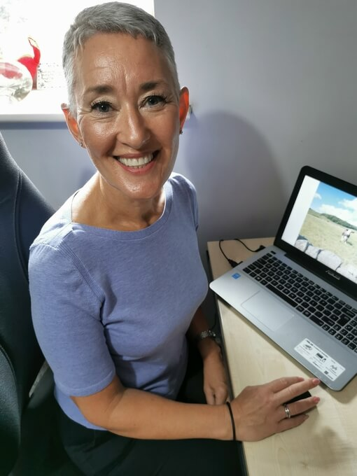 Photo of Susan Utting-Simon at her computer ready to help you with Online Counselling